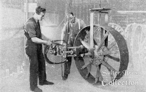 Riveting travel wheels with pneumatic riveter